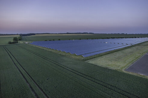 Germany, aerial view of solar fields at Nothern Harz foreland at evening twilight - PVCF000554