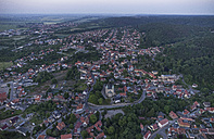 Germany, aerial view of Gernrode with collegiate church St. Cyriakus in the evening - PVCF000571