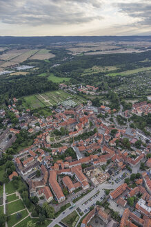 Germany, aerial view of Quedlinburg with collegiate church in the evening - PVCF000574