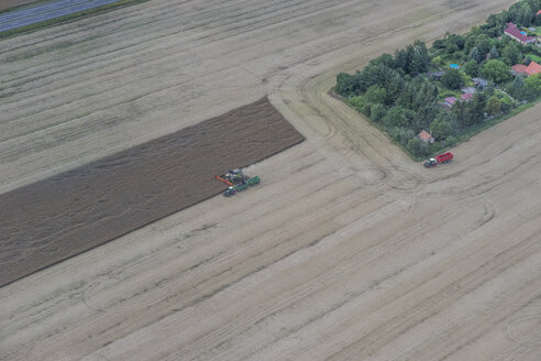 Germany, aerial view of combine harvester at work on a field - PVCF000604