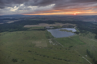 Germany, aerial view of solar fields near Halberstadt at evening twilight - PVCF000582