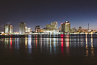 USA, New Orleans, Downtown reflected in the Mississippi river at night - GIOF000089