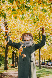 Woman throwing autum leaves in the air - CHAF001117