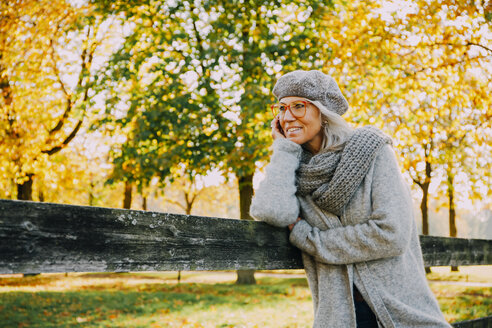Portrait of woman wearing grey knitwear in an autumnal park - CHAF001129