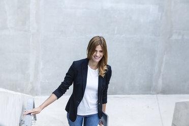 Portrait of smiling businesswoman - FMKF001747
