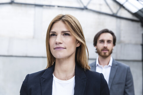 Portrait of businesswoman with her partner in the background - FMKF001755