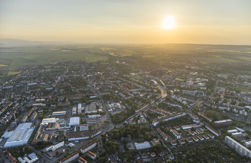 Germany, aerial view of Halberstadt with Harz low mountain range in the background at evening twilight - PVCF000592