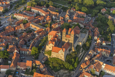 Germany, aerial view of Quedlinburg with collegiate church at evening twilight - PVCF000595