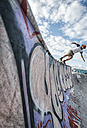 Young man skateboarding in a skatepark - MGOF000420