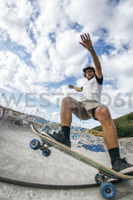Young man skateboarding in a skatepark - MGOF000421
