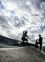 Young man skateboarding in a skatepark - MGO000443