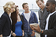 Group of friends outdoors sharing digital tablet - STKF001375