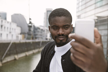 Young man taking a selfie outdoors - STKF001406