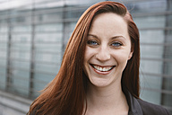 Portrait of happy young woman outdoors - STKF001409