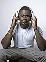 Relaxed young man with headphones - STKF001427