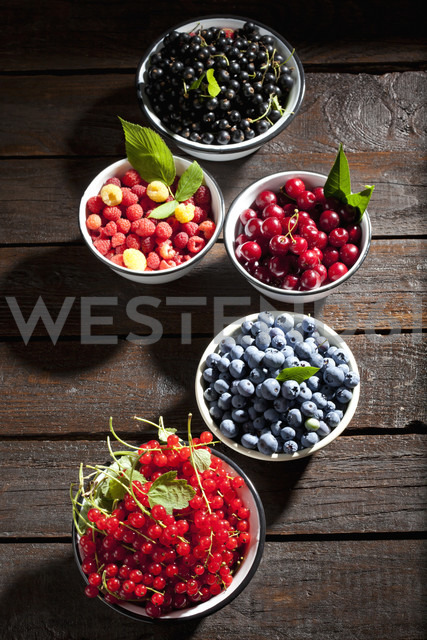 Bowls of sour cherries, raspberries, red and black currants and blueberries - CSF026123