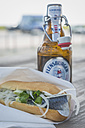 Germany, Sylt, fish sandwich and beer bottle - KEB000228