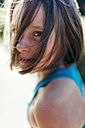 Portrait of girl with brown hair and freckles - MGOF000433