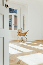 Pram in empty room, open doors - CHAF001054