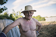 Portrait of shirtless farmer with straw hat - RAEF000296