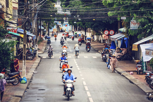 Vietnam, Mekong Delta, motorbike riders on a busy road - EH000147