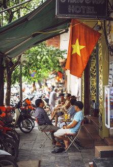 Vietnam, Hanoi, people at a sidewalk cafe - EH000143