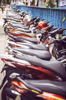 Vietnam, parking of motorbikes on roadside - EHF000139