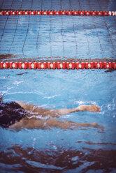 Female swimmer in indoor pool - EH000127