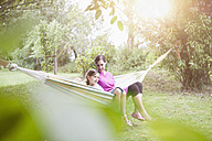 Relaxed mother and daughter in hammock - RBF003451