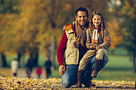 Portrait of little girl with her father in an autumnal park - CHAF001081