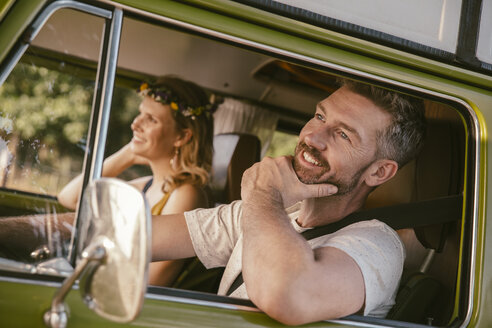 Smiling couple in van on a road trip - MFF002049