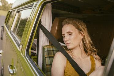Woman sleeping in van - MFF002052