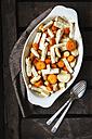 Roasted root vegetable, carrot, parsnip and celeriac on casserole dish - EVGF002090