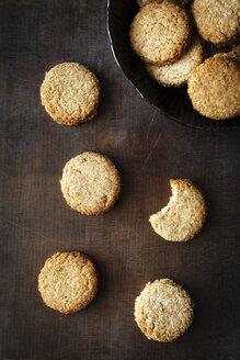 Bowl of whole grain cocos cookies  on dark wood - EVGF002082