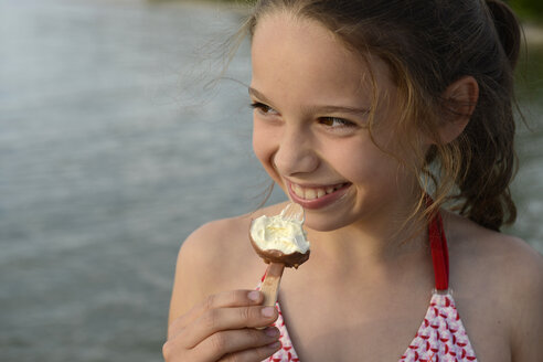 Portrait of smiling girl with popsicle - LBF001173