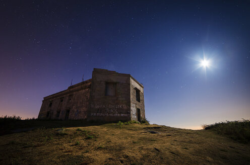 Spain, Ferrol, Monteventoso, ruin of a military building at moonlight - RAEF000385