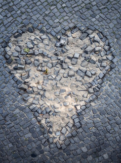 Destroyed pavement formed like a heart - OPF000069