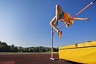 Young athlete training high jump - STSF000855