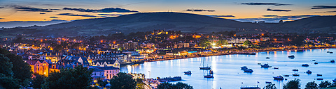 United Kingdom, Dorset, Isle of Purbeck, Swanage, seaside holiday resort illuminated at sunset - FV000017