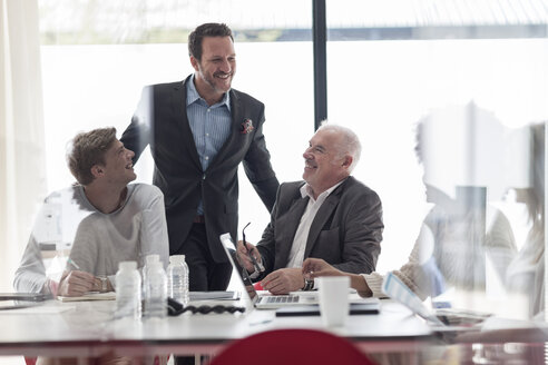Confident businesspeople in conference room - ZEF007445