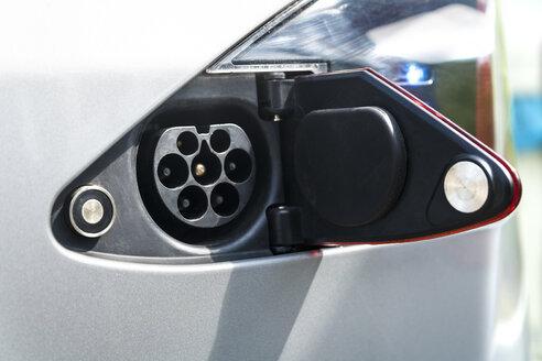 Open tank cap of an electric car - TCF004841