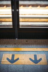 Thailand, Bangkok, Arrow signs at florr of skytrain - EHF000211