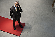 Confident businessman on the phone - TOYF001158