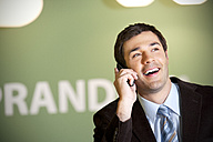 Smiling businessman on the phone - TOYF001248