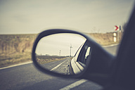 Germany, Brandenburg, reflection  of wind turbines in wing mirror on a country road - ASCF000328
