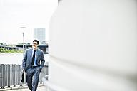 Walking businessman with briefcase - UUF005372