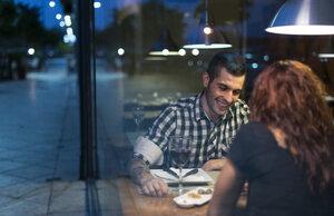 Young couple in modern restaurant having dinner - JASF000002