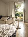Modern living room with view through open terrace door - LAF001486
