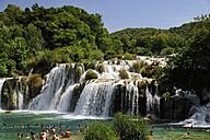 Croatia, Krka National Park, Skradinski buk, tourists bathing in pool at waterfall - BTF000381