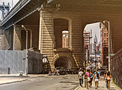 USA, New York City, Pillars of Brooklyn Bridge with Empire Stat Building in background - ON000868
